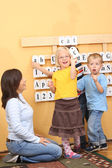 Teacher and three preschoolers during lesson — Stock Photo