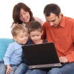 Family using laptop — Stock Photo #4667571