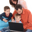 Royalty-Free Stock Photo: Family using laptop