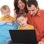 Family using laptop — Stock Photo #4667629