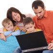 Family using laptop - Stock Photo