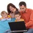 Family using laptop — Stock Photo #4667633