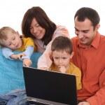 Family using laptop — Stock Photo #4667635