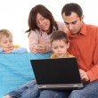 Family using laptop — Stock Photo #4667638