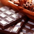 Chocolate with delicacies — Stock Photo