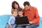 Family using laptop — Stock Photo