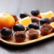 Chocolate and orange pralines - Stock Photo