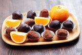 Chocolate and orange pralines — Stock Photo