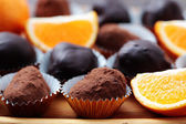 Chocolate and orange pralines — Stock Photo