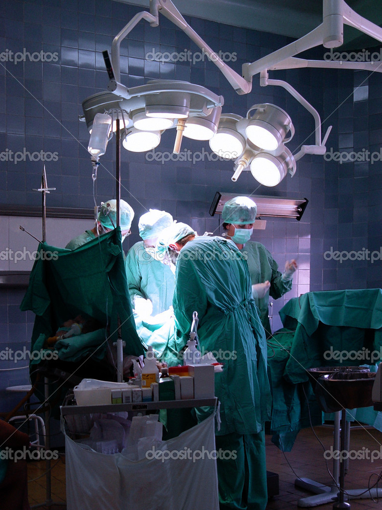 Surgeons in operative room — Stock Photo #2713773