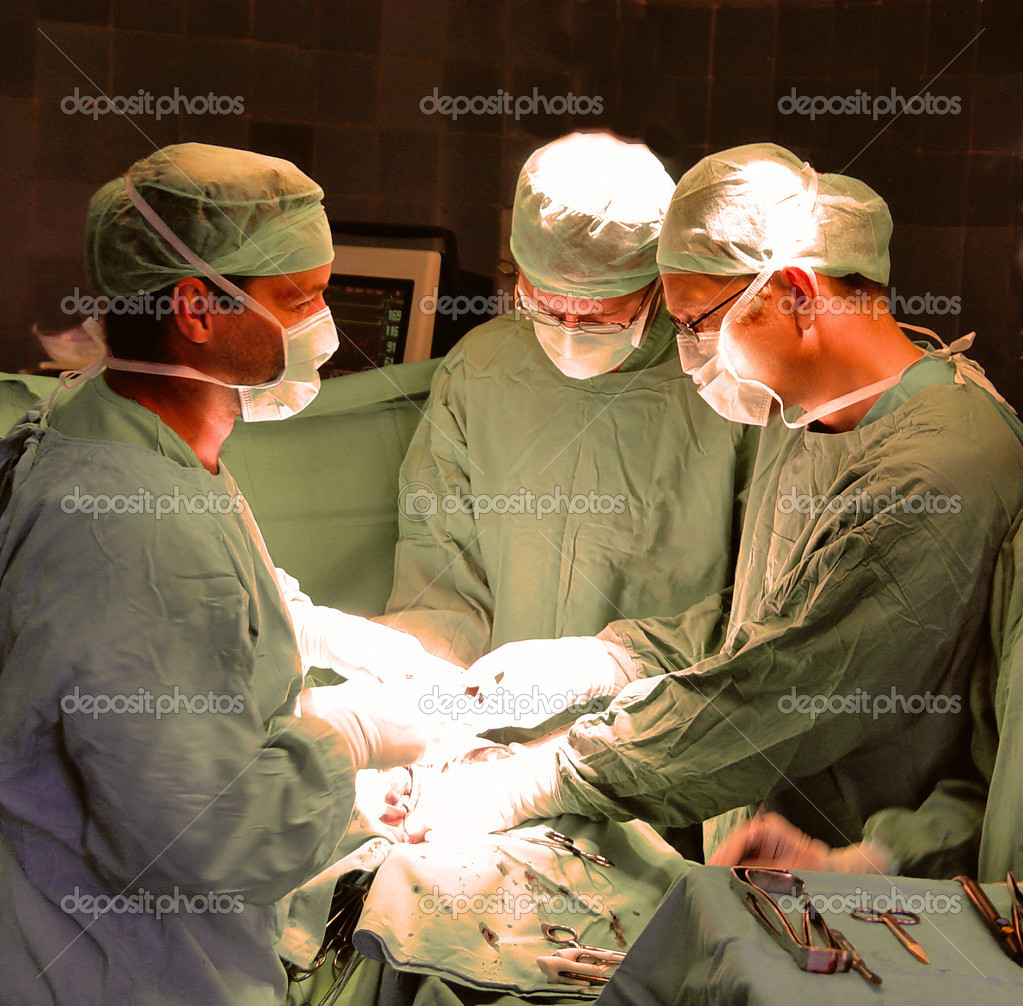Surgeons in operative room — Stock Photo #2713797