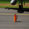 A red fire extinguisher - Stock Photo