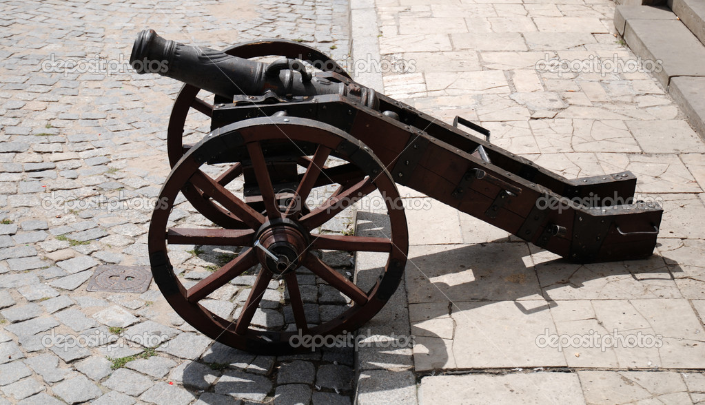 Old gun on wheels about a fortification. — Stock Photo #3036866