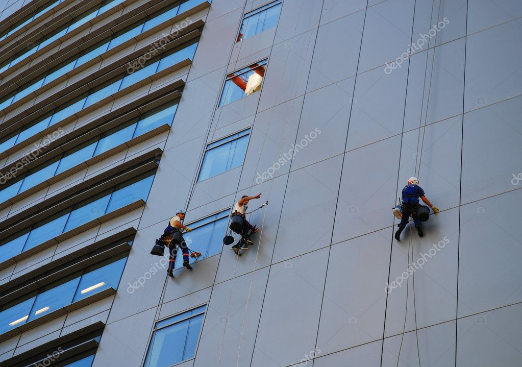 Image of climbing up the wall of building — Stock Photo #3046138