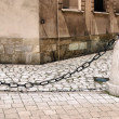 Royalty-Free Stock Photo: Ancient rusty chain and stone column