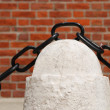 Ancient rusty chain and stone column — Foto Stock
