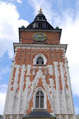 Town hall with clock in summer Krakow — Stock Photo