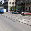 The tram is going down the street in Cracow - Stock Photo