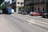 The tram is going down the street in Cracow — Stock Photo