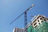 Steel crane at building site — Stok fotoğraf