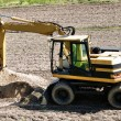 Photo of a working excavator in the countryside — Stock Photo #3797998