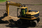 Photo of a working excavator in the countryside — Stock Photo