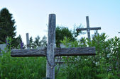 Wooden cross on the grave — Foto Stock