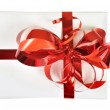 Gift with red bow isolated — Stock Photo