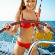 Girl driving a yacht - Stock Photo
