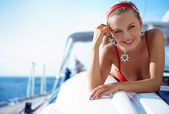 Girl on a yacht — Stock Photo