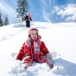 little girl playing on the snow — Stock Photo #2756447