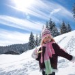 Stock Photo: Little girl playing on snow