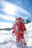 Little girl playing on the snow — Stock Photo