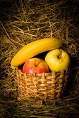 Collection of fruits in basket — Stock Photo
