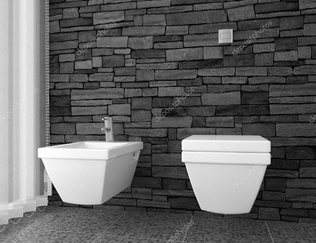 Baño moderno con muro de piedra negra y el equipo blanco — fotos ...