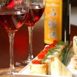 Sushi and red wine — Stock Photo