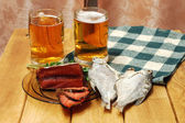 Beer and fish on table — Stock Photo