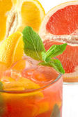 Fresh cocktail with an orange and mint — Stock Photo