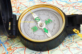 Compass on a map — Stok fotoğraf