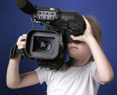 Little girl and big camera — Stock Photo