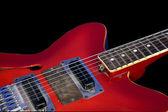 Red guitar — Stockfoto