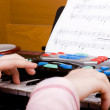 Playing at toy piano — Stock Photo