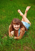 Woman Holding A Blade Of Grass — Stock Photo
