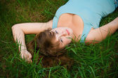 Woman Lying On A Grass — Stock Photo