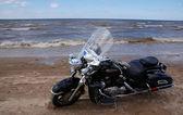 Motorcycle on seacoast — Stock Photo
