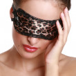 The girl in a leopard mask for eyes - Stock Photo
