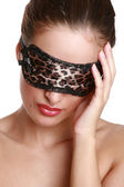 The girl in a leopard mask for eyes — Stock Photo