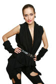 Young woman in a modern black dress — Stockfoto