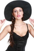 Fashionable girl in black bonnet — Stock Photo