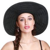 Fashionable girl in black bonnet — Stock Photo
